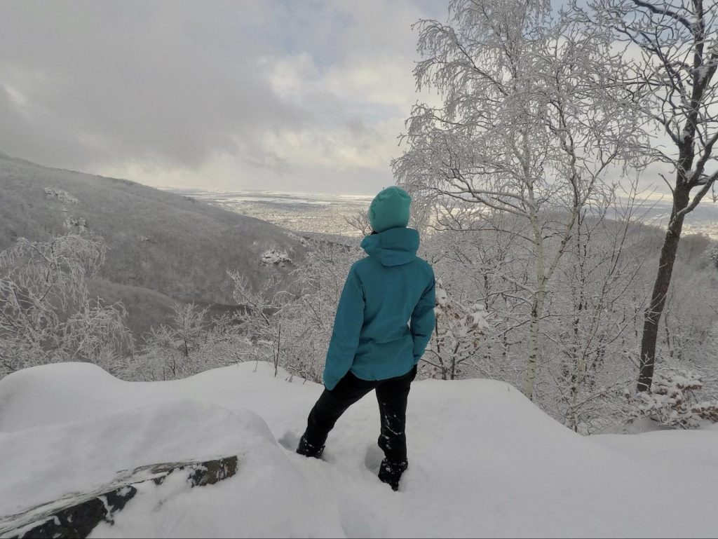 A hiker on a snowy slope of Vitosha Mountain in Bulgaria